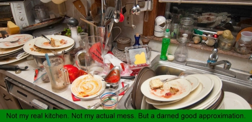 39182534 - dirty dishes over flowing in a kitchen sink